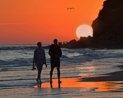 Strolling At Sunset By Brian Clark